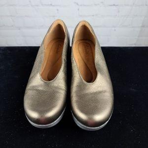 Clarks Claribel Flare Bronze Leather Wedge…